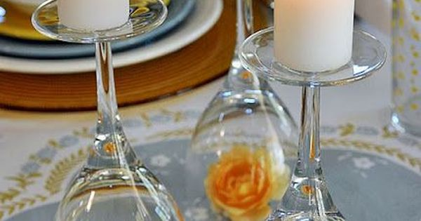 fantastic table decoration idea, wine glass candle holders with flower etc inside