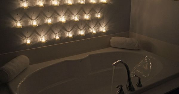hanging candles on bathroom wall.. what a statement! Master bathroom