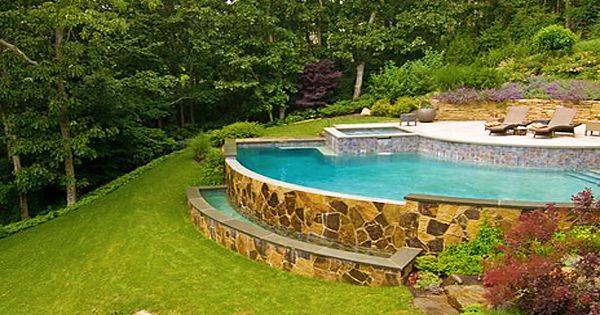 How To Build A Pool What To Do With A Sloped Backyard Sloped Backyard Backyard Pool Landscaping Swimming Pools Backyard