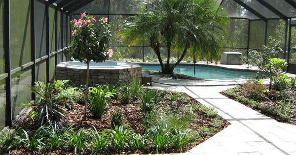 A lanai in odessa florida is divided into 3 outdoor for Rooms under the garden