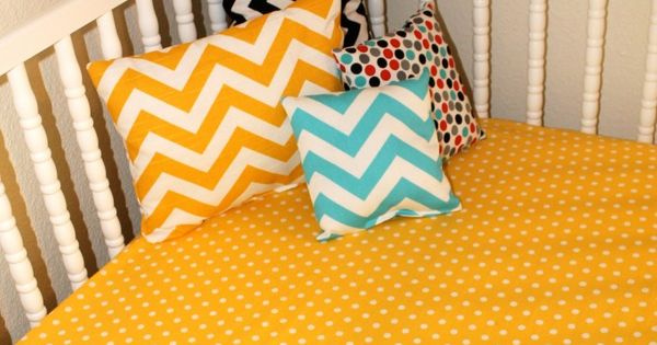 Red and green chevron pillows to contrast with yellow chevron bedspread