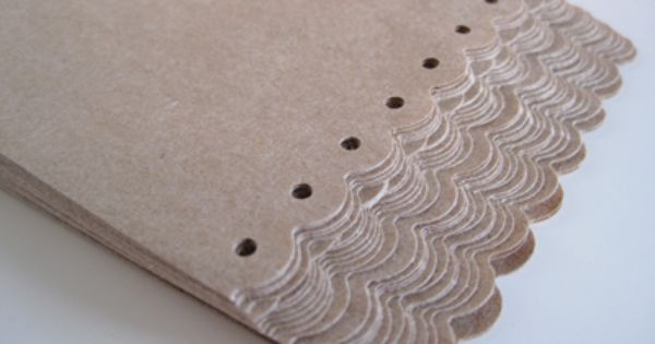 Gift wrap idea: Taking brown paper bags and using punches to trim