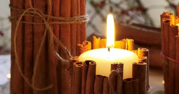 Tie cinnamon sticks around your candles. the heated cinnamon makes your house