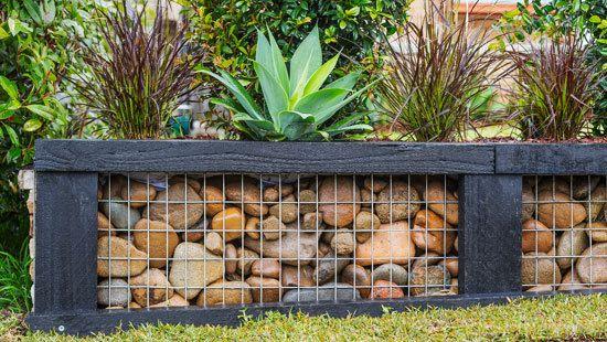 Mixed Materials Stone Wood Metal Backyard Retaining Walls Diy Retaining Wall Garden Wall