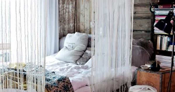 This bohemian style bedroom is perfection paired with deep hardwood floors and