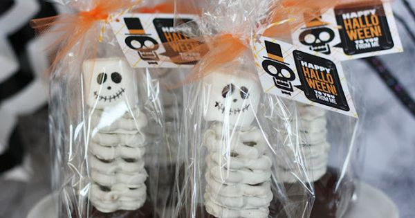 Brownie and pretzel skeletons! Brownie base, white chocolate covered pretzels topped with