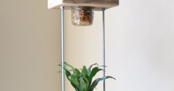 Vertical indoor garden. With salvaged wood, threaded rods and bolts, and a