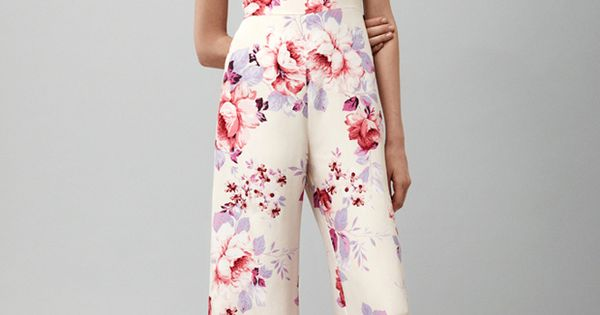 Floral patterns AND a jumpsuit. I'm so in love!