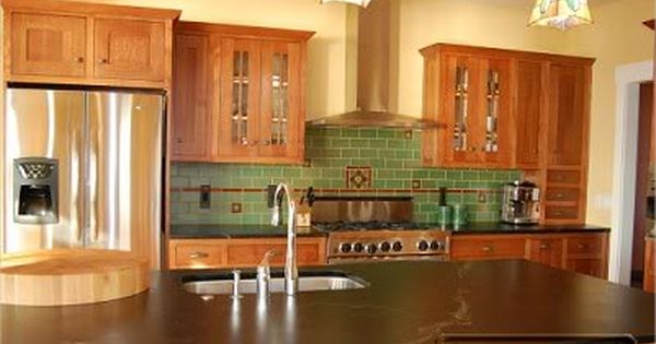 Golden oak kitchen cabinets with black countertops for Kitchen remodel keeping oak cabinets