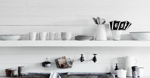 White kitchen with a concrete sink in the beautiful, rustic barn at ...
