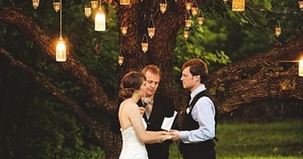 for an outdoor wedding. hang mason jars with candles? borrow some lanterns?
