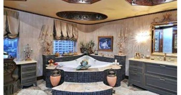 Step Up And Into This Large Jacuzzi Tub That Is The Centerpiece Of