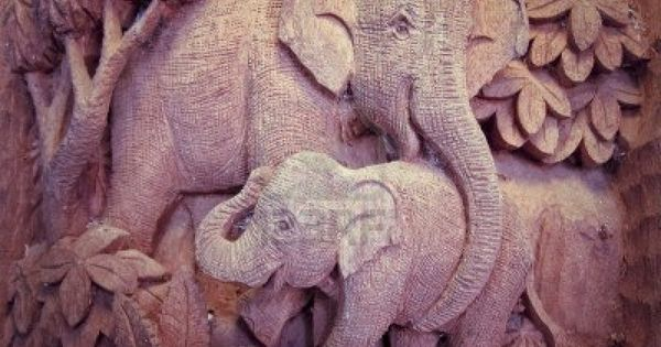 Elephant in forest high relief carving and