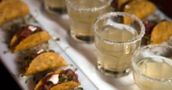 Mini tacos and margaritas in shot glasses for a ocean side wedding!