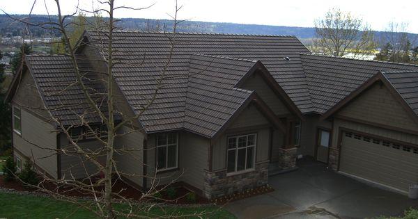 Beautiful rambler with a daylight basement brown tones for Beautiful rambler homes