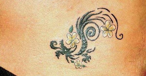 Yellow hawaiian flower tattoo. Im thinking something similar to this for my