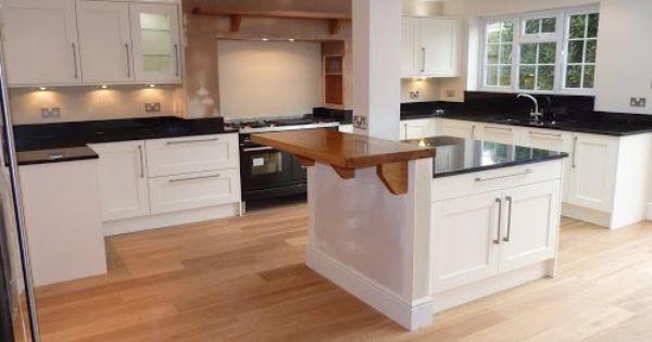 Black Granite Kitchen Worktop : Indian black granite worktops and white cupboards in a kitchen ...