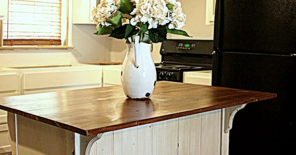 old dresser, kitchen island with seating