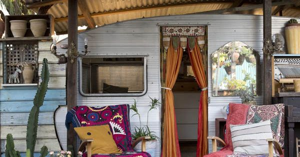 Colorful porch furnishings--entrance to a luscious vintage trailer converted to bedroom via:MadameB-exterior2