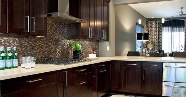 Good wall color and backsplash choice with dark cabinets and lighter floor.