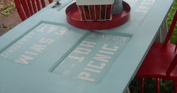 Upcycled door = picnic table....great color, too! So cute, no outdoor space