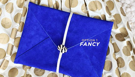 Gold polka dot dress with cobalt envelope clutch