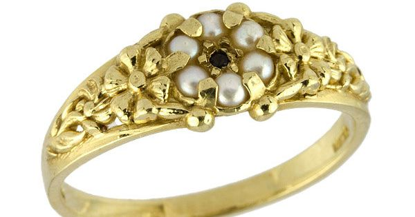 Pearls and a black diamond on a gold band