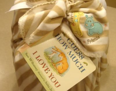 Baby Shower gift wrapping idea. Wrap gift in a baby blanket, tie