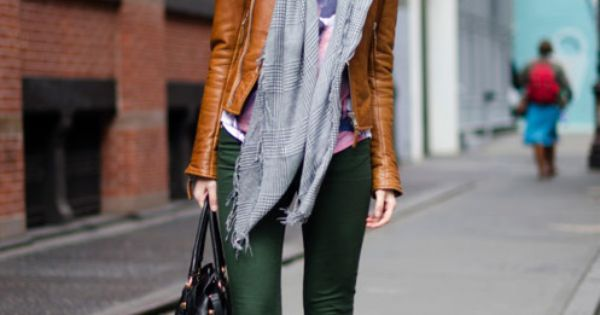 Street style, deep green pants leather coat and scarf.