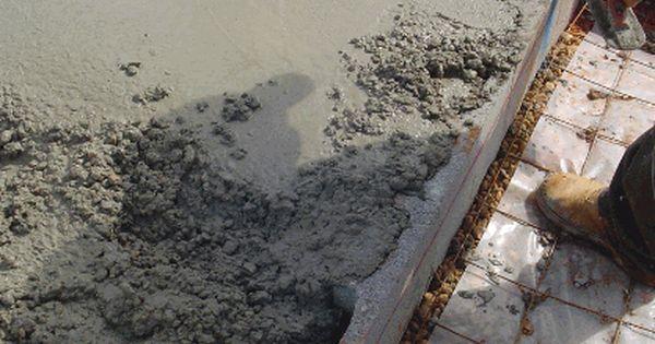 Edge Of Concrete Slab Being Poured With Anchor Bolt And Header Blocks Concrete Block Walls Concrete Block Foundation Concrete