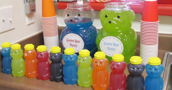 Gummy bear juice in animal cracker containers for candy themed party