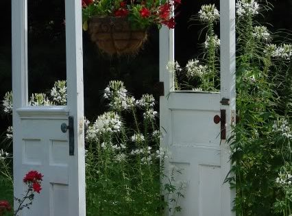 Old Door Arbor, great idea. I saw this with a bench between