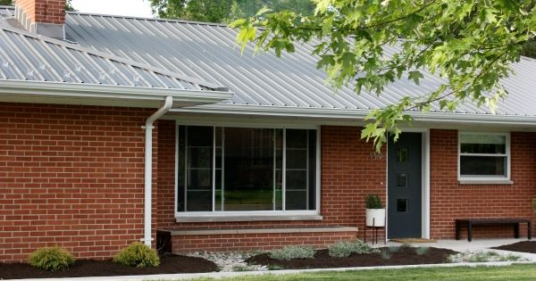 Red brick house with metal roof house plan 2017 for Metal roof pictures brick house