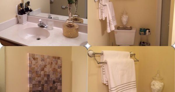 Cream colored bathroom with gold white and taupe accents for Cream and gold bathroom accessories