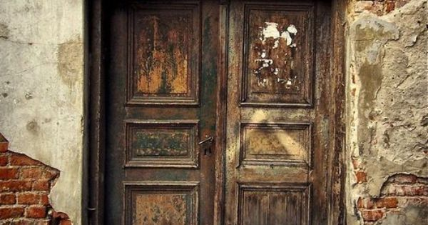 brown dress with white dots...... love old doors and decay