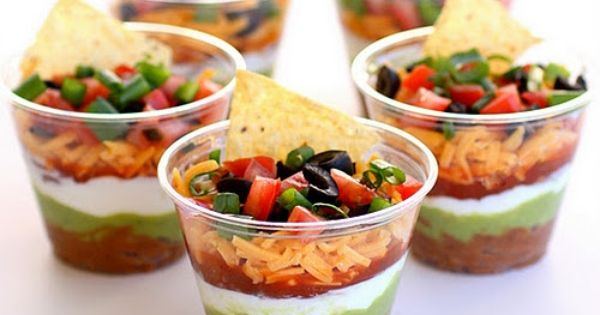 Individual Seven Layer Dips. Ingredients: 1 (16 ounce) can refried beans 1