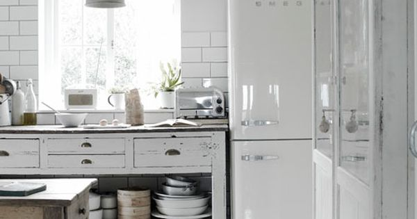 white Smeg refrigerator, white subway tile (with dark grout), wood floors painted