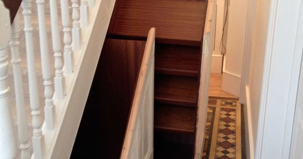 how to build pull out storage under stairs