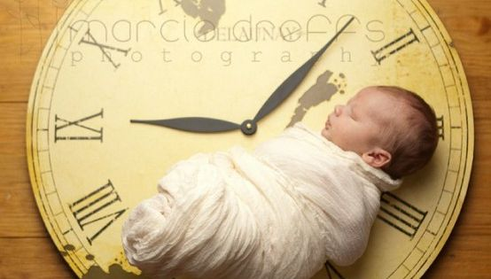 Newborn photography idea clock set to time of birth.