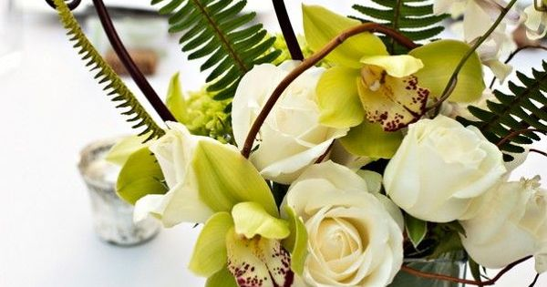 fiddle & reg. ferns with orchids & white roses... corn stalk leaves