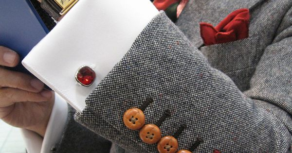 Red Cuff Stitching on Grey Suit