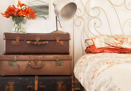 old trunks for an end or bedside table. The iron bed is