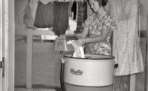 "September 1938. ""Farm wife washing clothes. Lake Dick Project, Arkansas."" 35mm negative"