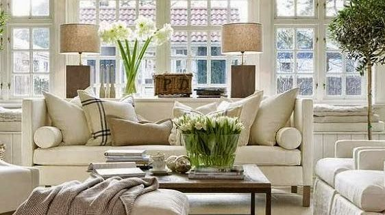 I like the bench along the window, white room and trees
