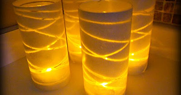 Dollar Store Glass Vase Luminaries- just need spray paint, yarn, tape, and