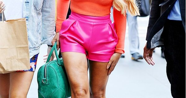 Beyoncé wears an orange crop top, pink leather shorts ...