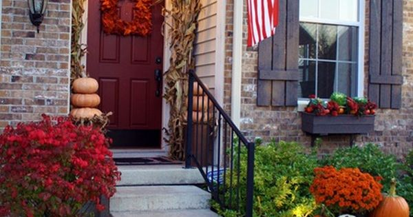 Love the Fall decor for small porch and Red door