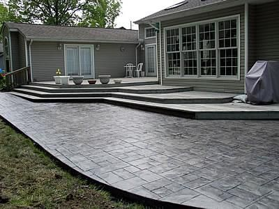 The Concrete Was Stamped With An Ashlar Slate Pattern And Colored Using Light Grey Hardener With A Charcoal Release Concrete Patio Patio Design Cement Patio