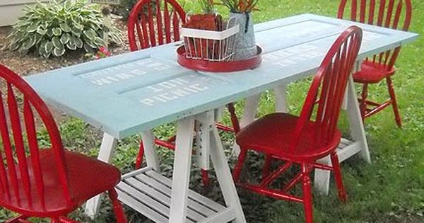 Picnic table made from old door... saw horses and repainted chairs... This