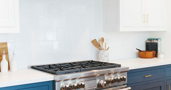 this navy blue and white kitchen features white 6x6 tile